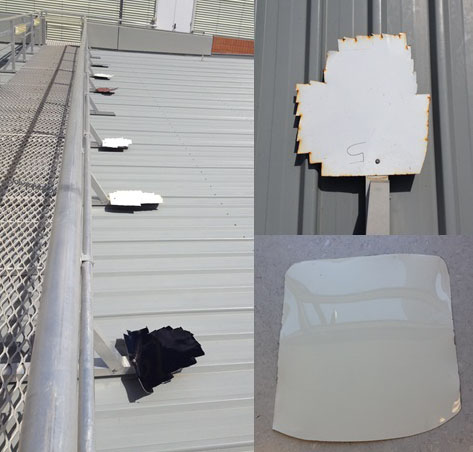 A view of a rooftop where paint samples in black, white and grey are being exposed to the sun