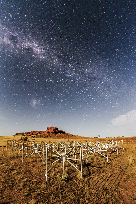 One of 256 tiles of the Murchison Widefield Array (MWA) radio telescope - small, white x-shaped panels set against the WA outback